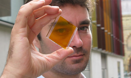 Dr. Henry Snaith from Oxford photovoltaics holding glass with printed solar cell